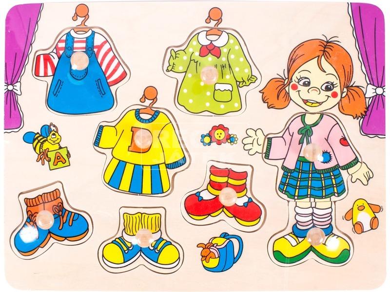 Fa öltöztető lány kirakó